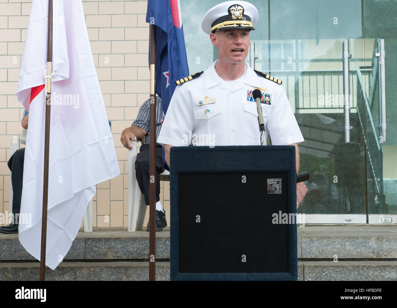 150622-N-MK341-029 Kolonia, POHNPEI, (June 22, 2015) – Commodore, Task Force Forager Capt. James Meyer delivers - Stock Image