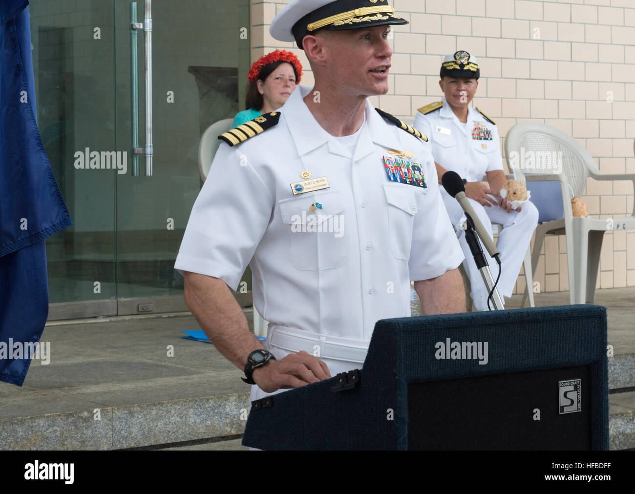 150622-N-MK341-032 Kolonia, POHNPEI, (June 22, 2015) – Commodore, Task Force Forager Capt. James Meyer delivers - Stock Image