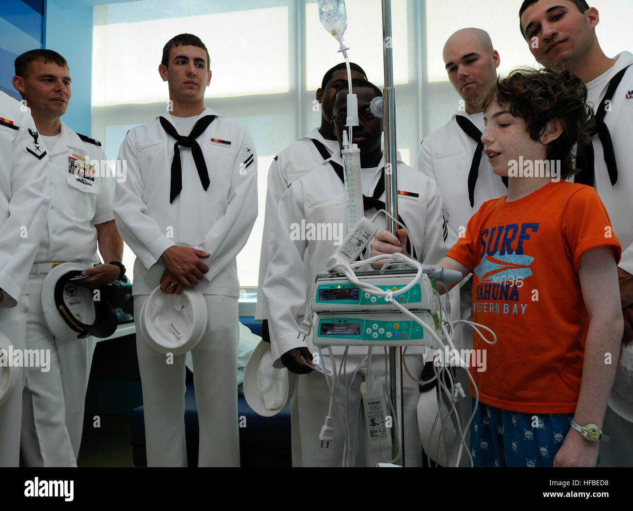 The guided-missile cruiser USS San Jacinto (CG 56) sailors visit Jacob Silverman during a community relation project - Stock Image