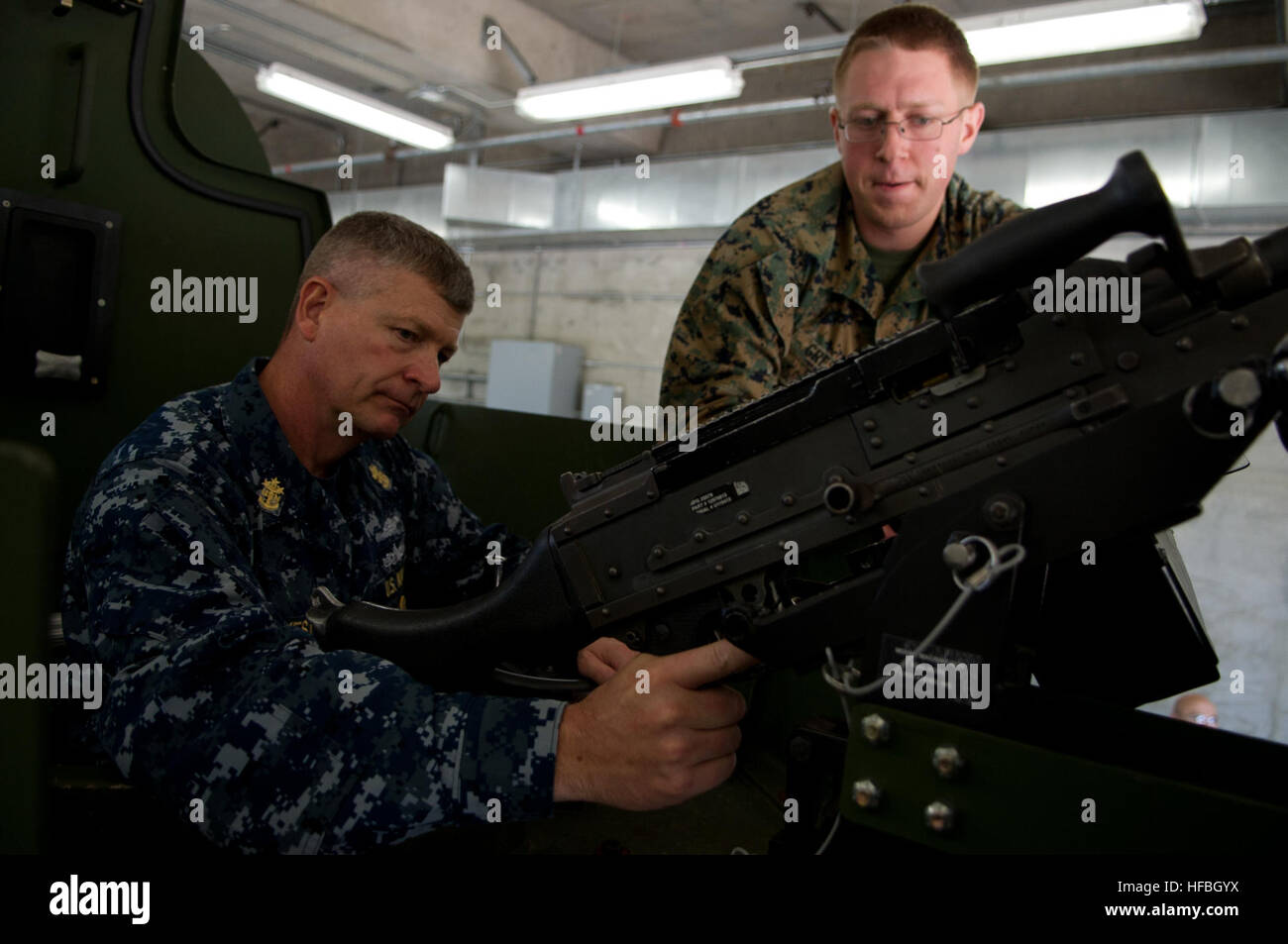 120726-N-IV546-068  BANGOR, Wash. (July 26, 2012) Lance Cpl. Justin Gresham shows Master Chief Petty Officer of - Stock Image