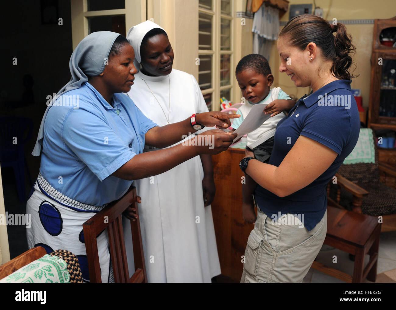 110216-N-6984M-001 TANGA, Tanzania (Feb. 16, 2011) Hospital Corpsman 2nd Class Cheryl Parker shows photographs of Stock Photo