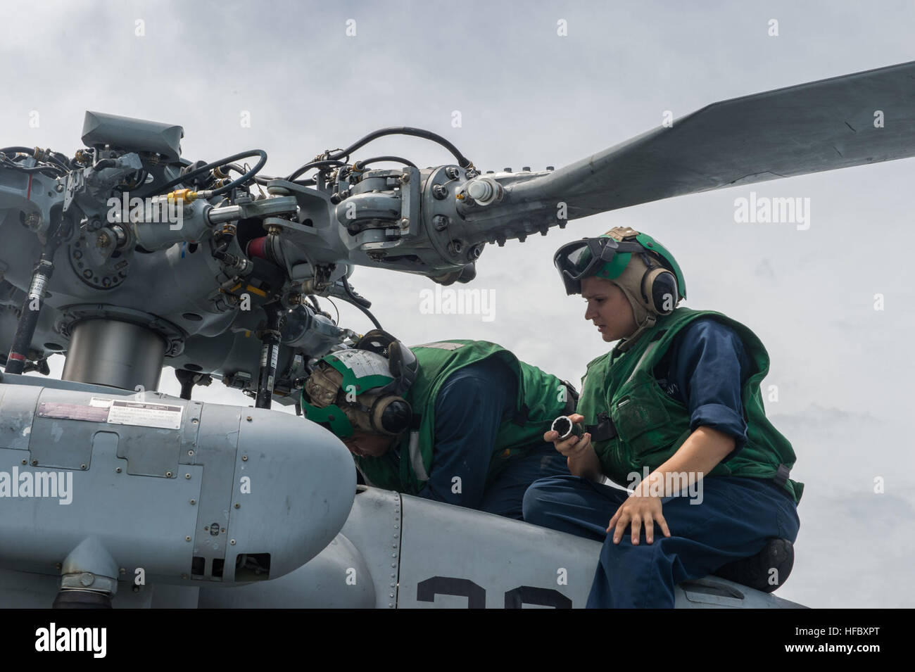 aviation machinists mate 2rd class edwin chiu and aviation structural mechanic 1st class anna kolesova attached to helicopter maritime strike squadron 35