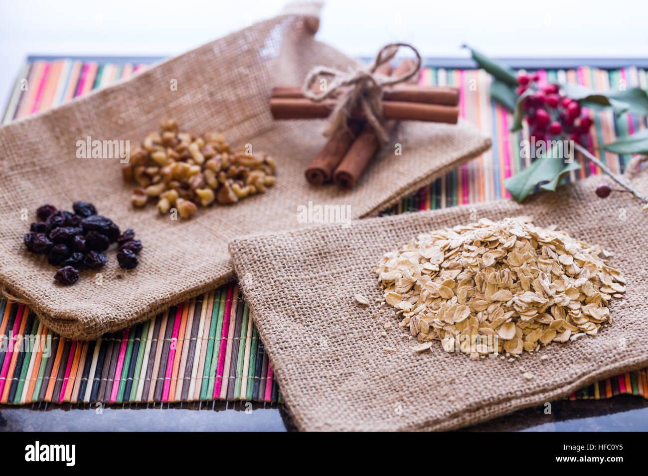 Oatmeal with raisins, walnuts, and cinnamon sticks. Stock Photo