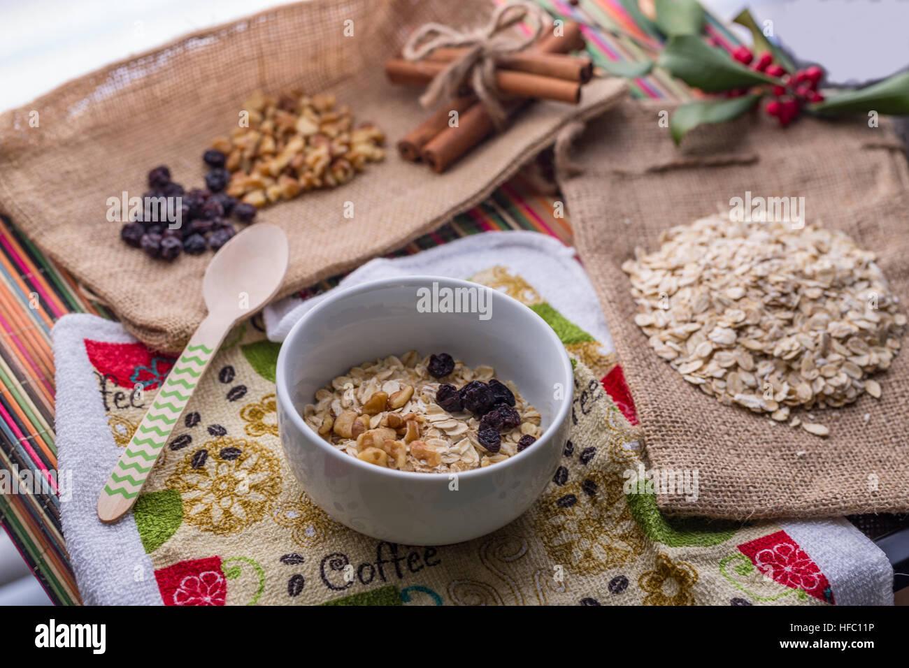 Oatmeal breakfast with walnut, raisin, and cinnamon in milk. - Stock Image