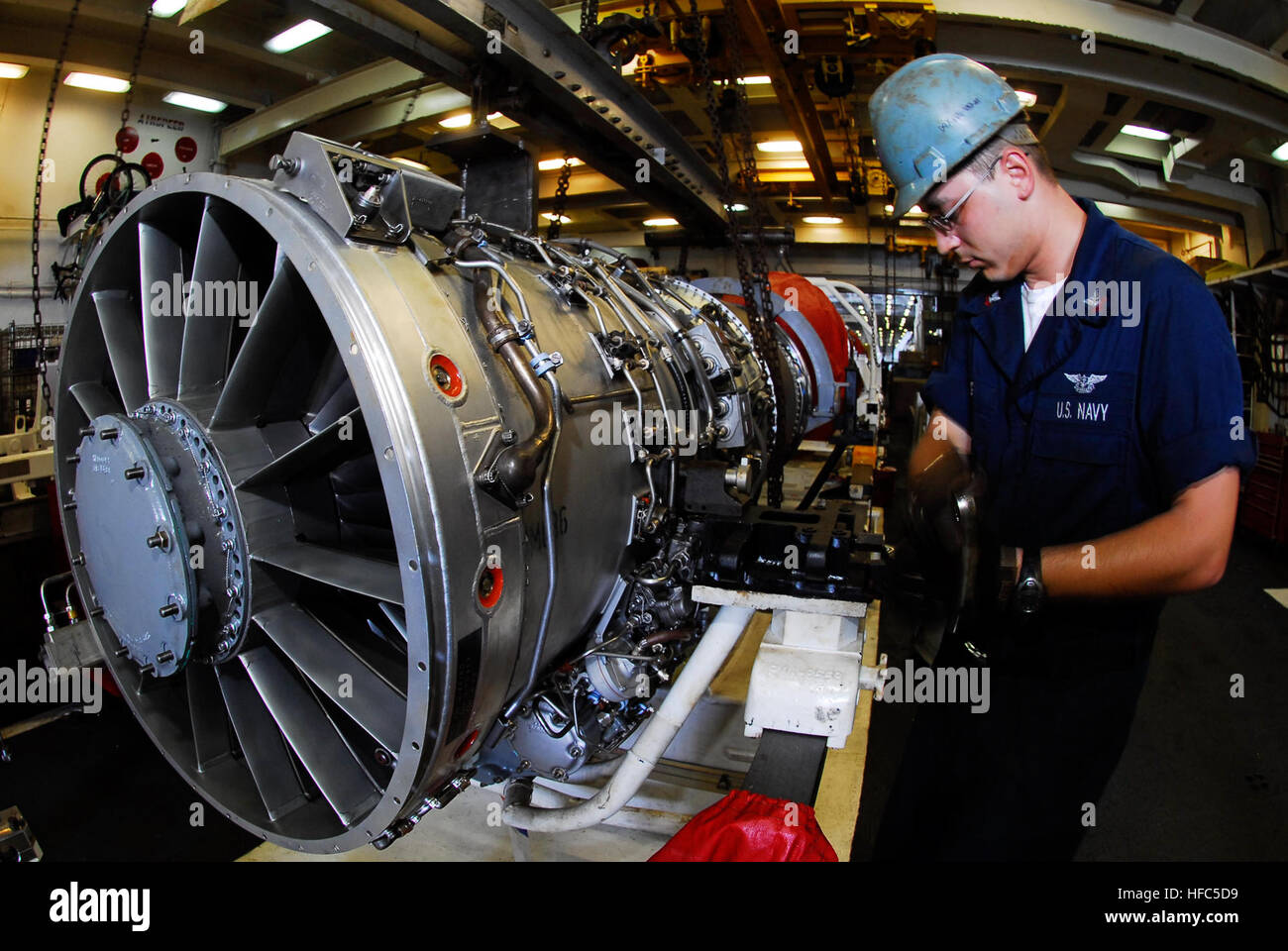 us navy aviation machinists mate 2nd class shaun elling prepares an ea 6b prowler pratt whitney j52 p 408 engine for transport in the aircraft carrier