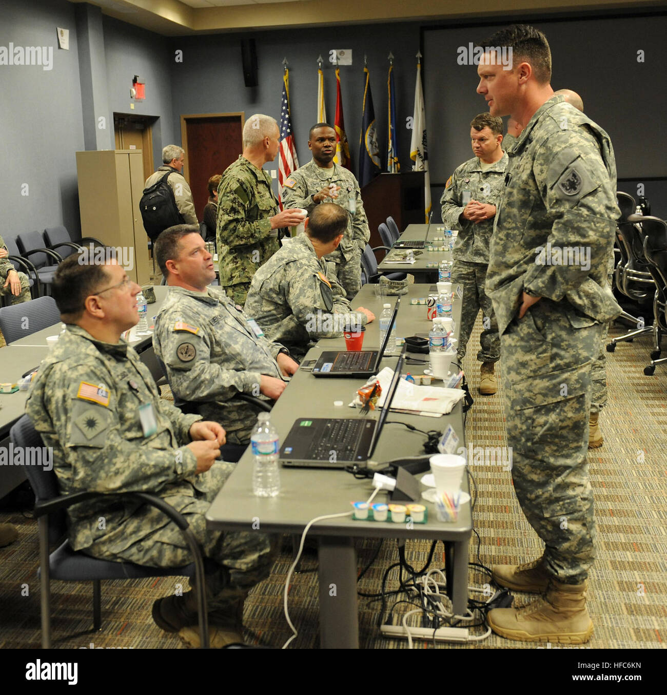 U.S. Army Lt. Col. Craig Benson, operations officer, 244th Aviation Brigade, speaks with his unit representatives - Stock Image