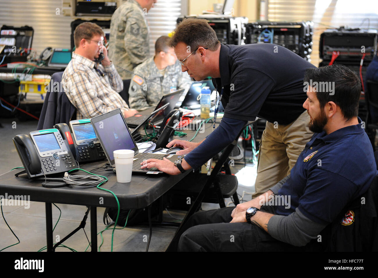 Rick George, communications control center chief, Joint Task Force Civil Support, and Karl Ludwig, deployed communications Stock Photo