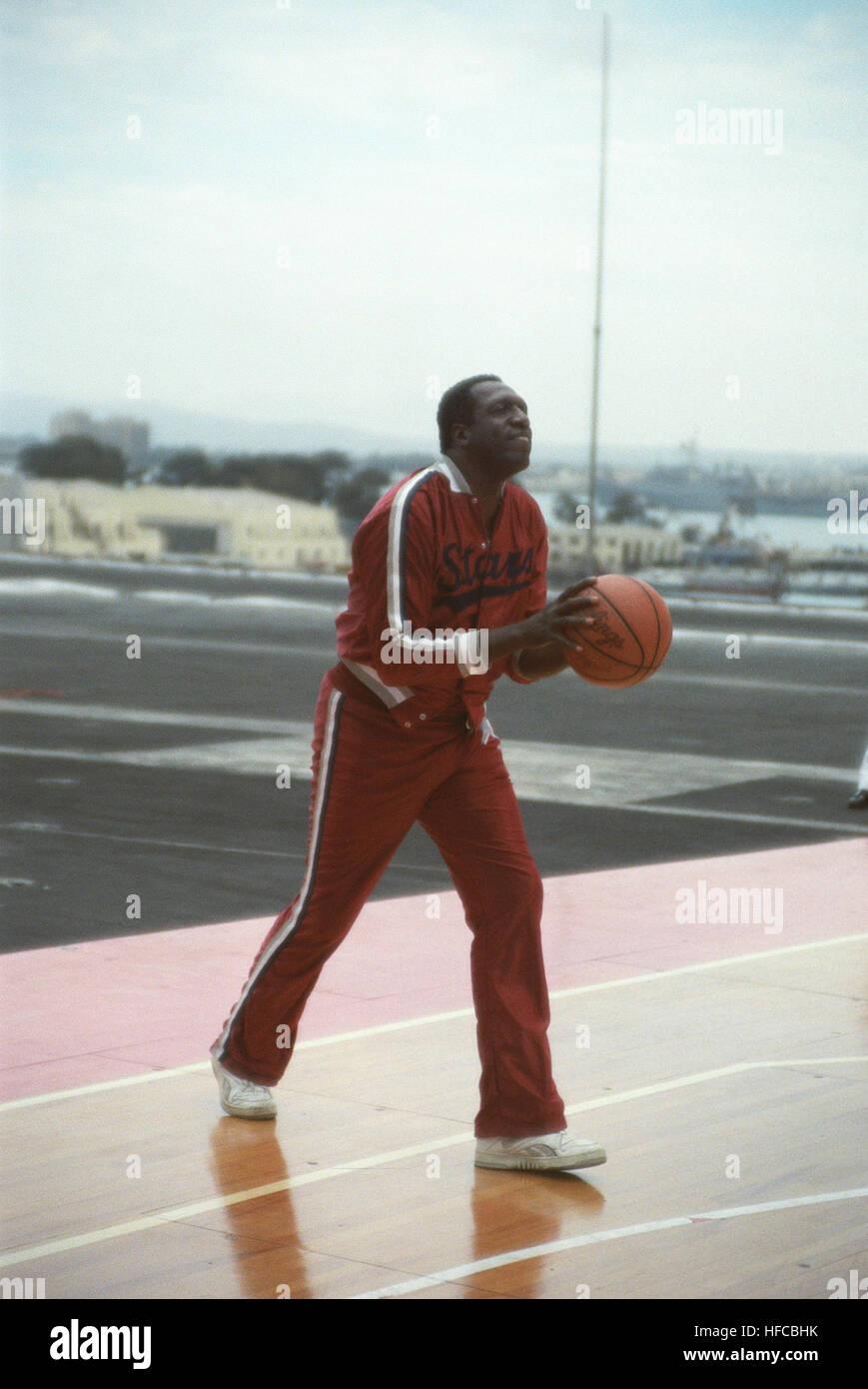 Star player, Meadowlark Lemon, formerly of the Harlem Globe Trotters, warms up for the game.  A  regulation basketball - Stock Image