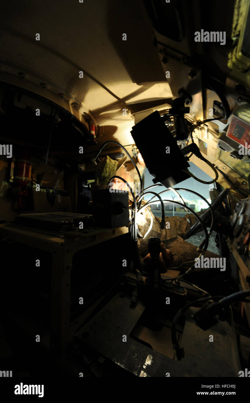 Electronics Technician 2nd Class Jarrod Long, assigned to Naval Mobile Construction Battalion 15, searches through - Stock Image
