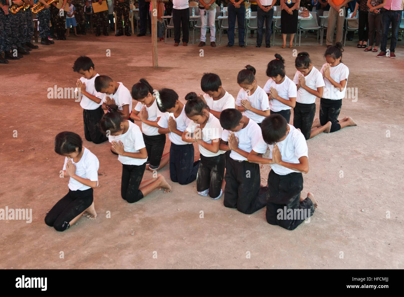 Children Perform A Traditional Filipino Dance With A Symbol Of