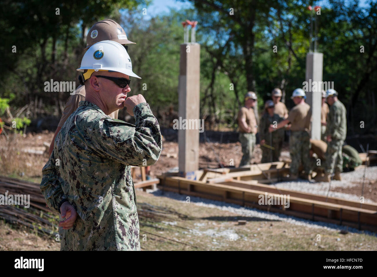 Capt. Rodney Moore, commodore of the 30th Naval Construction Regiment, observes an engineering project at the Tuadale - Stock Image