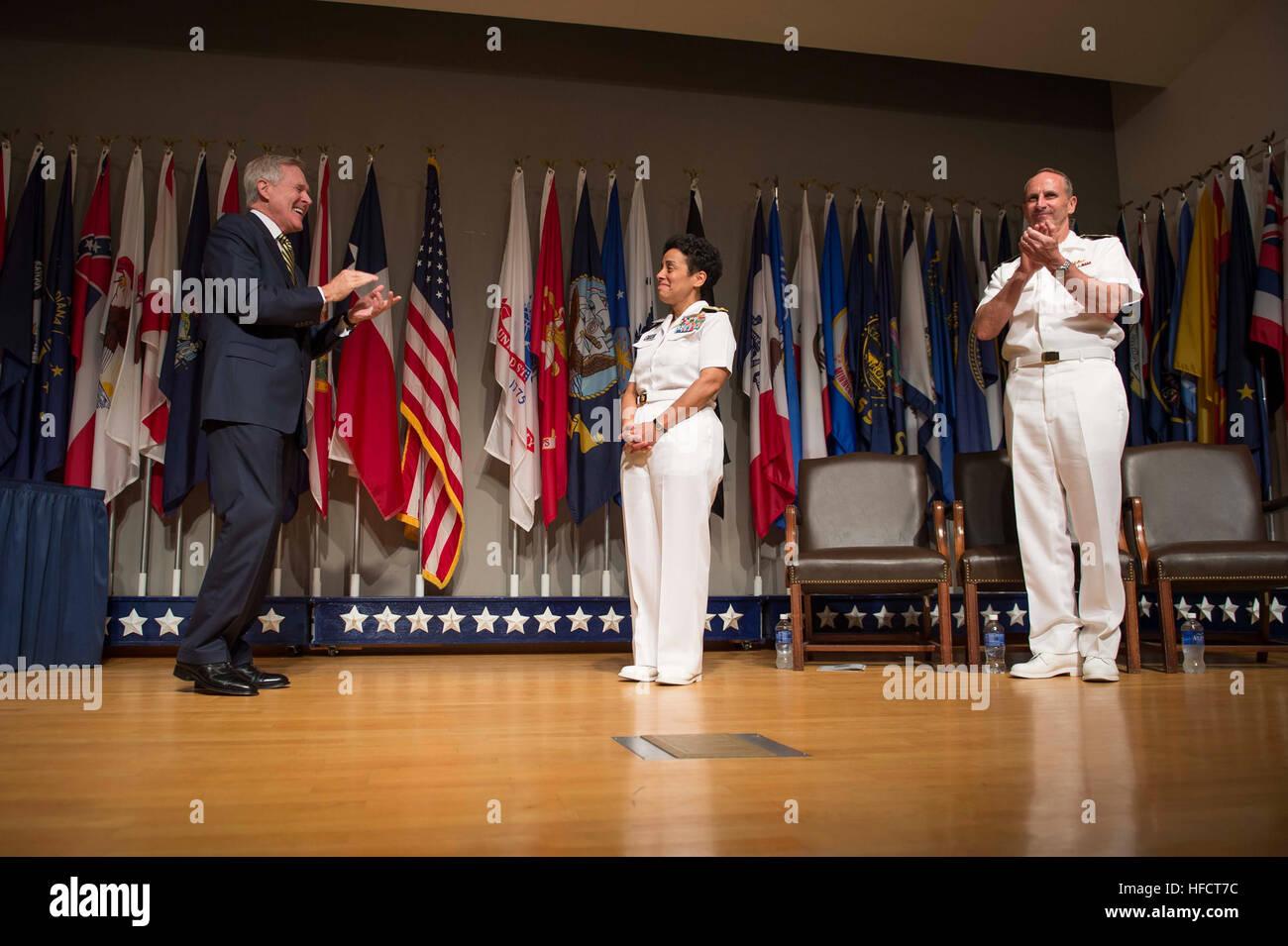 Secretary of the Navy Ray Mabus and Chief of Naval Operations (CNO) Adm. Jonathan Greenert applaud Adm. Michelle Stock Photo