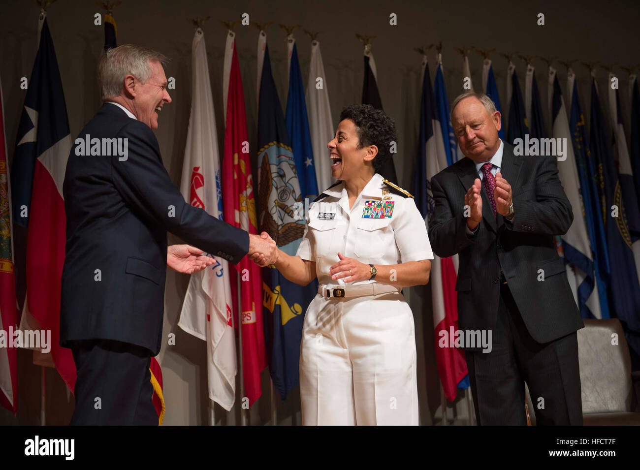 Secretary of the Navy Ray Mabus congratulates Adm. Michelle Howard after putting on her fourth star Tuesday, July Stock Photo