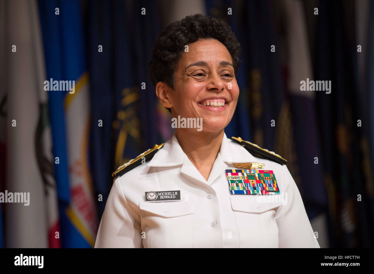 Adm. Michelle Howard smiles following her historic promotion to the rank of admiral at the Women in Military Service Stock Photo