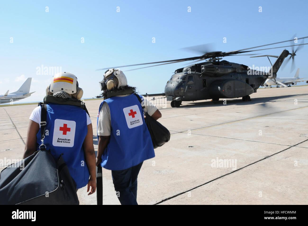GUANTANAMO BAY, Cuba – American Red Cross volunteers board an MH-35E Sea Dragon helicopter bound for Haiti at U.S. Stock Photo