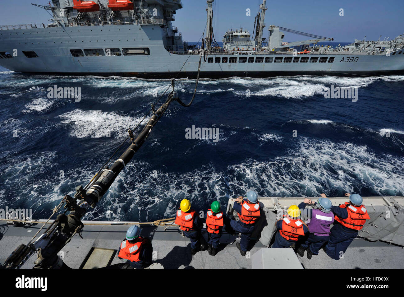 ARABIAN SEA (Nov. 6, 2012) Sailors aboard the guided-missile destroyer USS Jason Dunham (DDG 109) conduct a replenishment - Stock Image