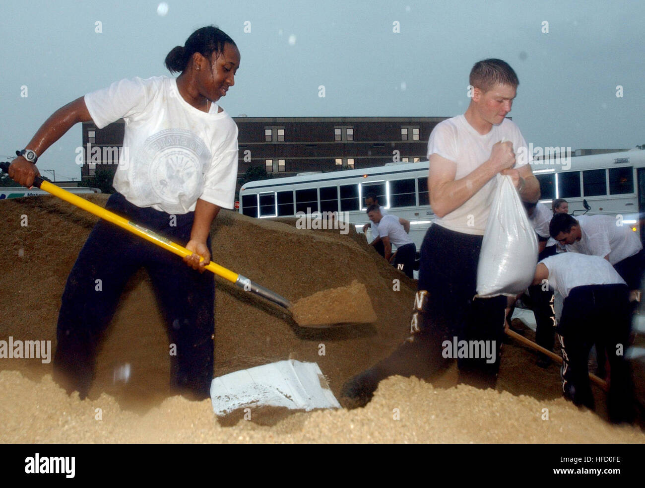 Seaman Kayla Days and Seaman Alex Mills, students at Naval Hospital Corps School, fill sandbags for delivery to Stock Photo