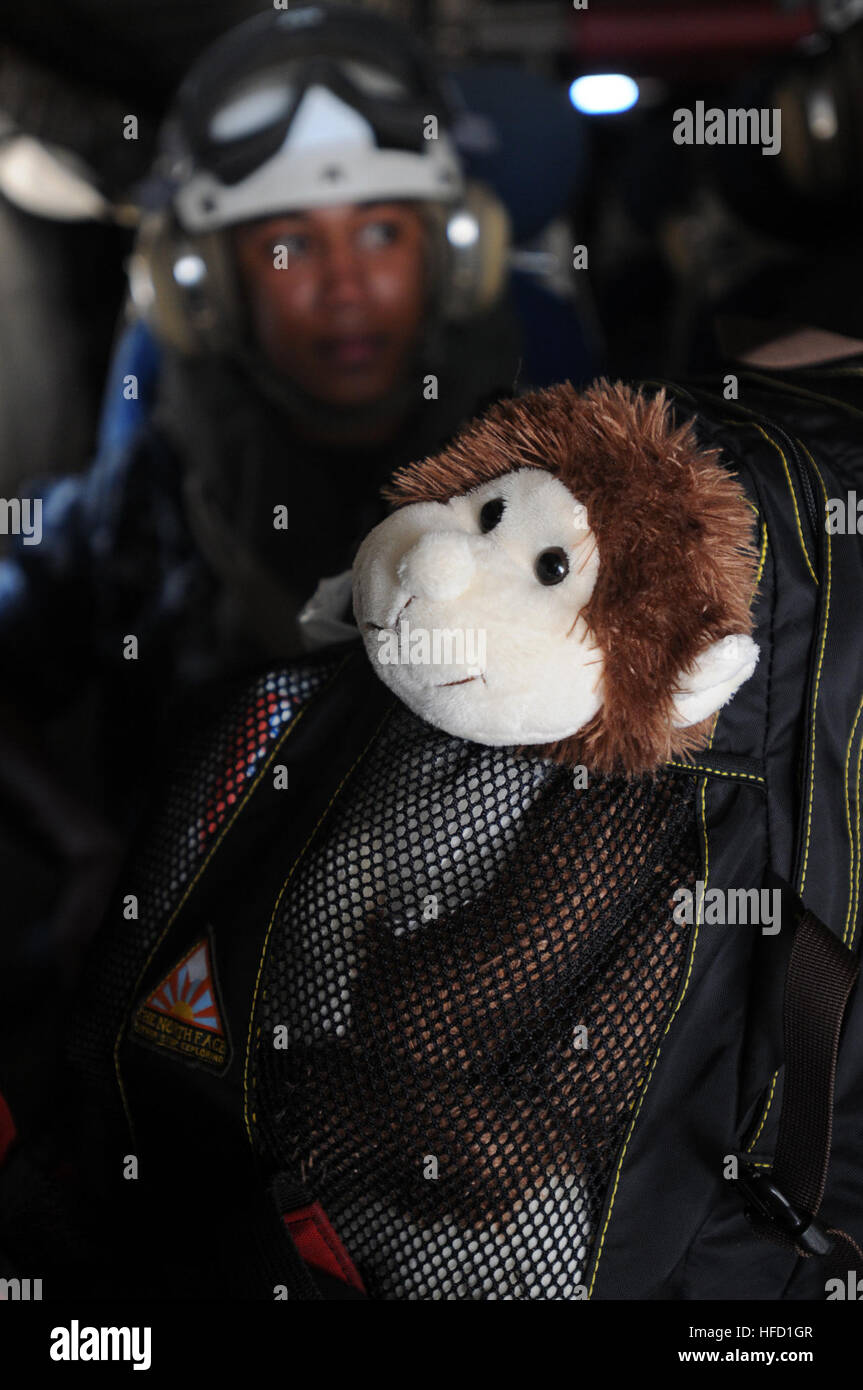 """""""Bob,"""" a plush monkey given to Seaman Apprentice Andrea Frank by her 3-year-old daughter, Kathryn, prepare to take Stock Photo"""