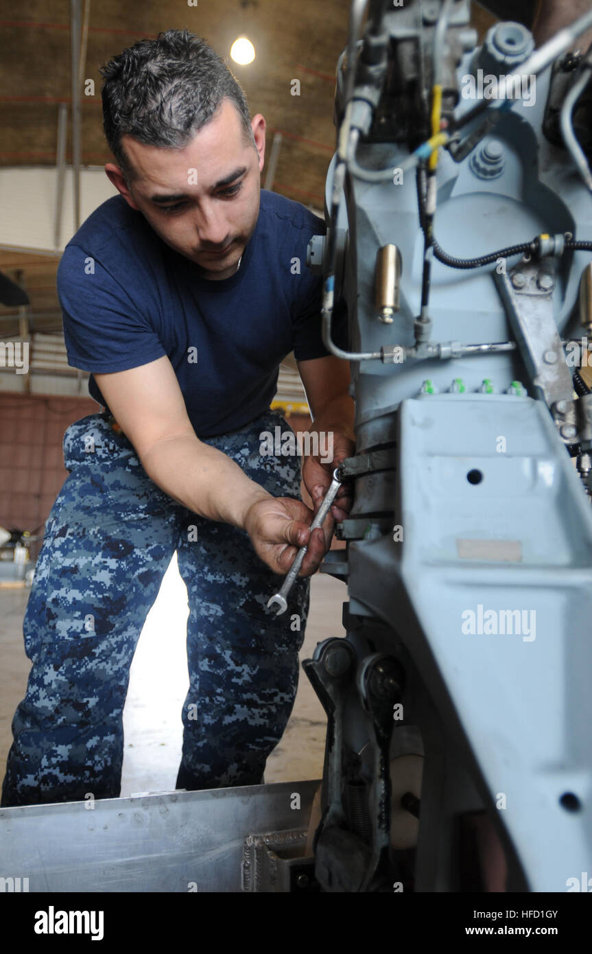 Petty Officer 2nd Class Timothy Morales, assigned to Helicopter Mine Squadron 15, does maintenance on the sleeve Stock Photo
