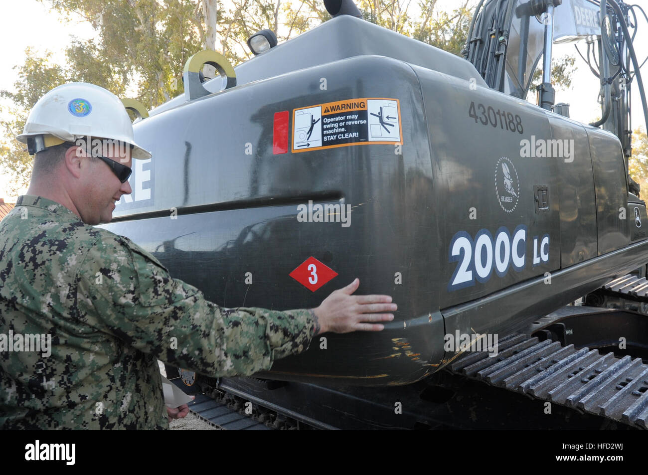 Chief Construction Mechanic Garin Leith, the maintenance chief assigned to Naval Mobile Construction Battalion 3's - Stock Image