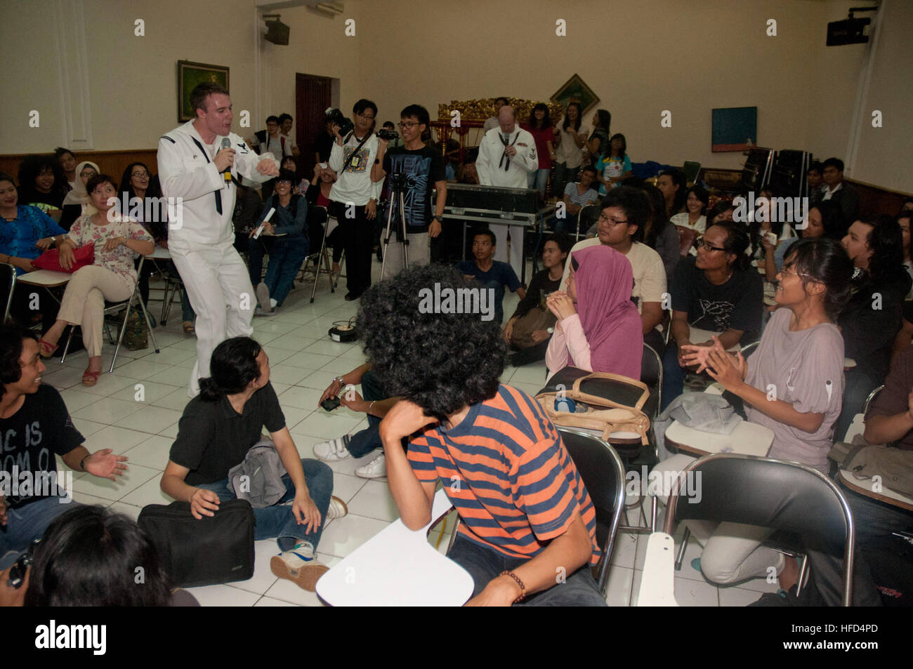 Musician 3rd Class Gabriel Brown, from the U.S. 7th Fleet Band, Orient Express, sings to Indonesian nationals at Stock Photo