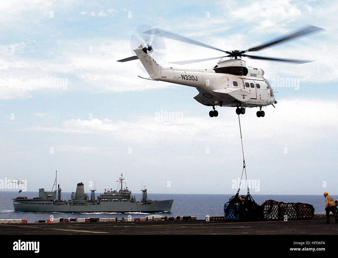 Commercially owned Super Puma helicopters from Military Sealift Command combat stores ship USNS Spica delivered Stock Photo
