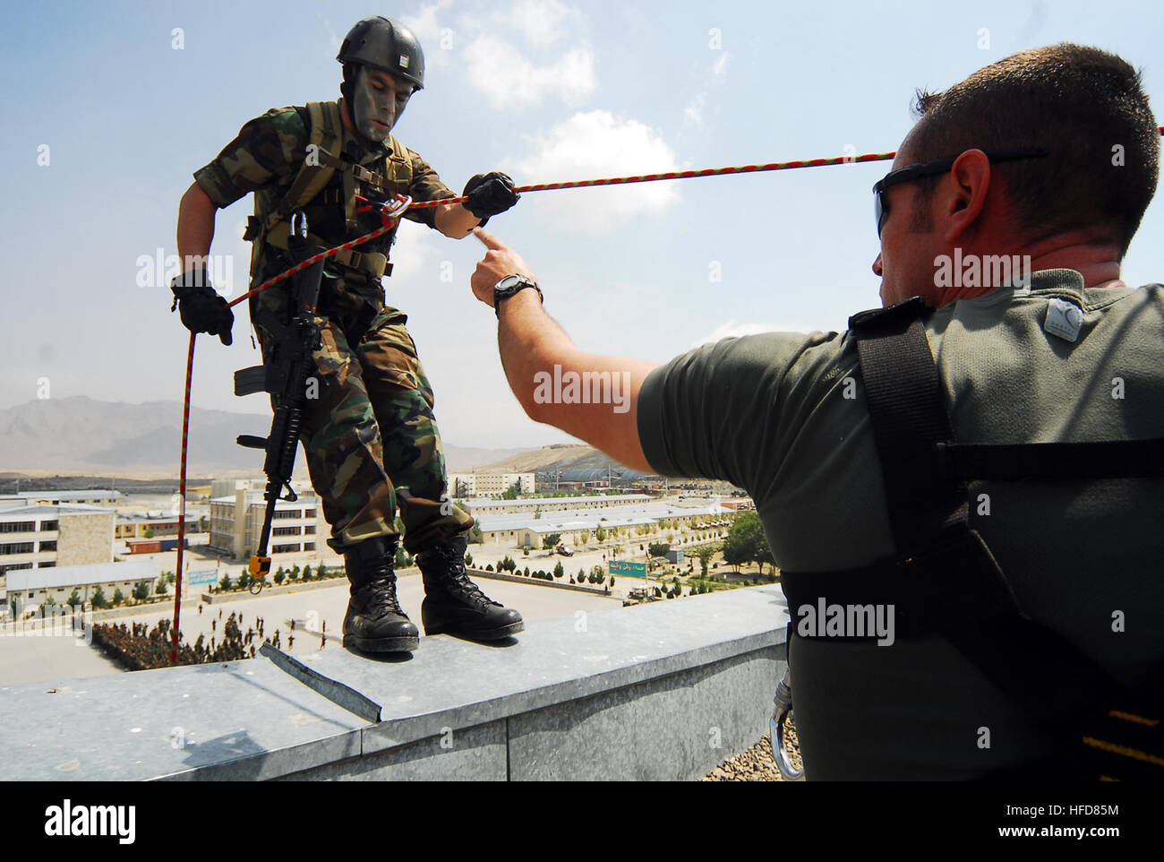 KABUL, Afghanistan (August 9, 2010)  French Army Staff Sgt. Virion, right, an EPIDOTE program Afghan National Army - Stock Image