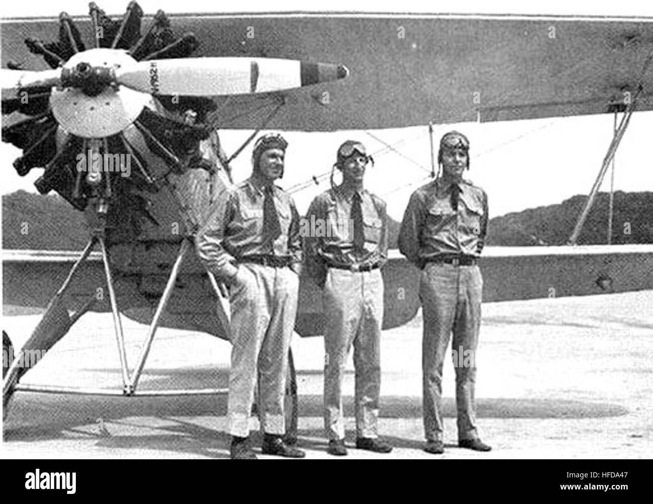 Three Flying Fish aerobatic team of 1933 and one of their Curtiss F6C Hawks - Stock Image
