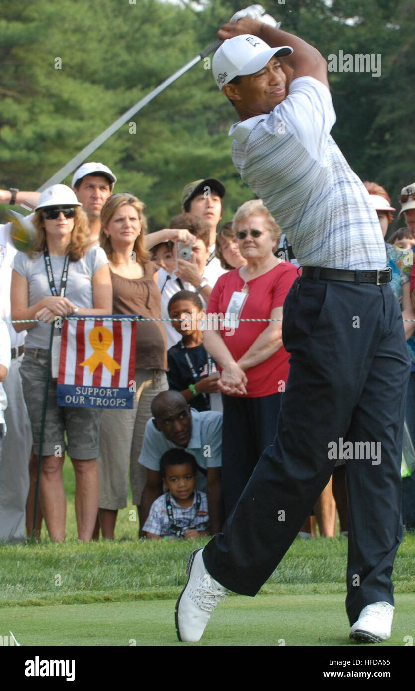 070704-N-2855B-005 Tiger Woods, Champion Golfer, drives the ball down range during the inaugural Earl Woods Memorial - Stock Image