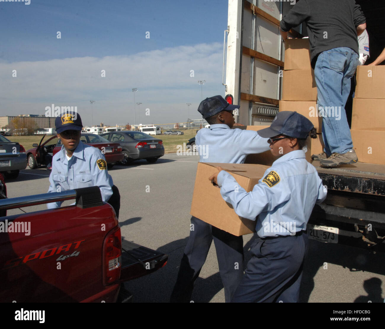 101120-N-8732C-011  WASHINGTON (Nov. 20, 2010) – U.S. Naval Sea Cadet Kendall Kent moves a box of food from a delivery Stock Photo
