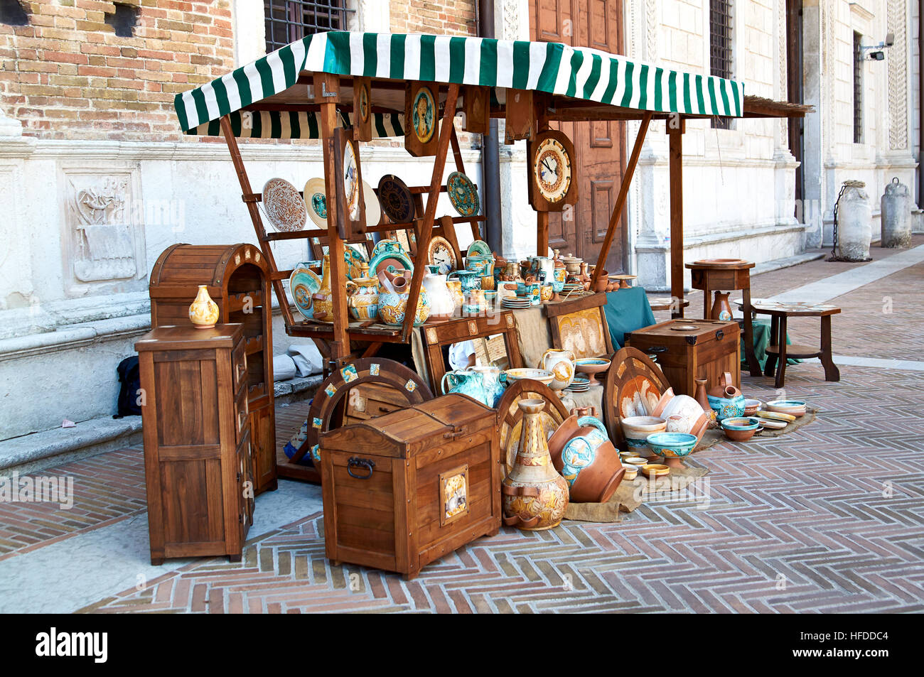 Village fair vintage Handicrafts. Pottery, leather and wooden objects on the table. On a Sunny summer day. - Stock Image