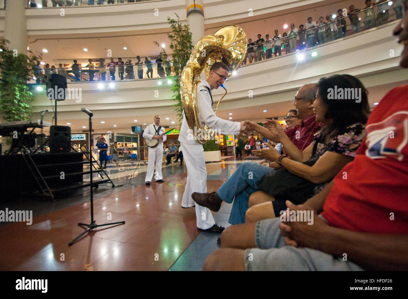 Musician 3rd Class Zachary Buckwash, assigned to the U.S. 7th Fleet Band, Far East Edition Brass Band, interacts Stock Photo