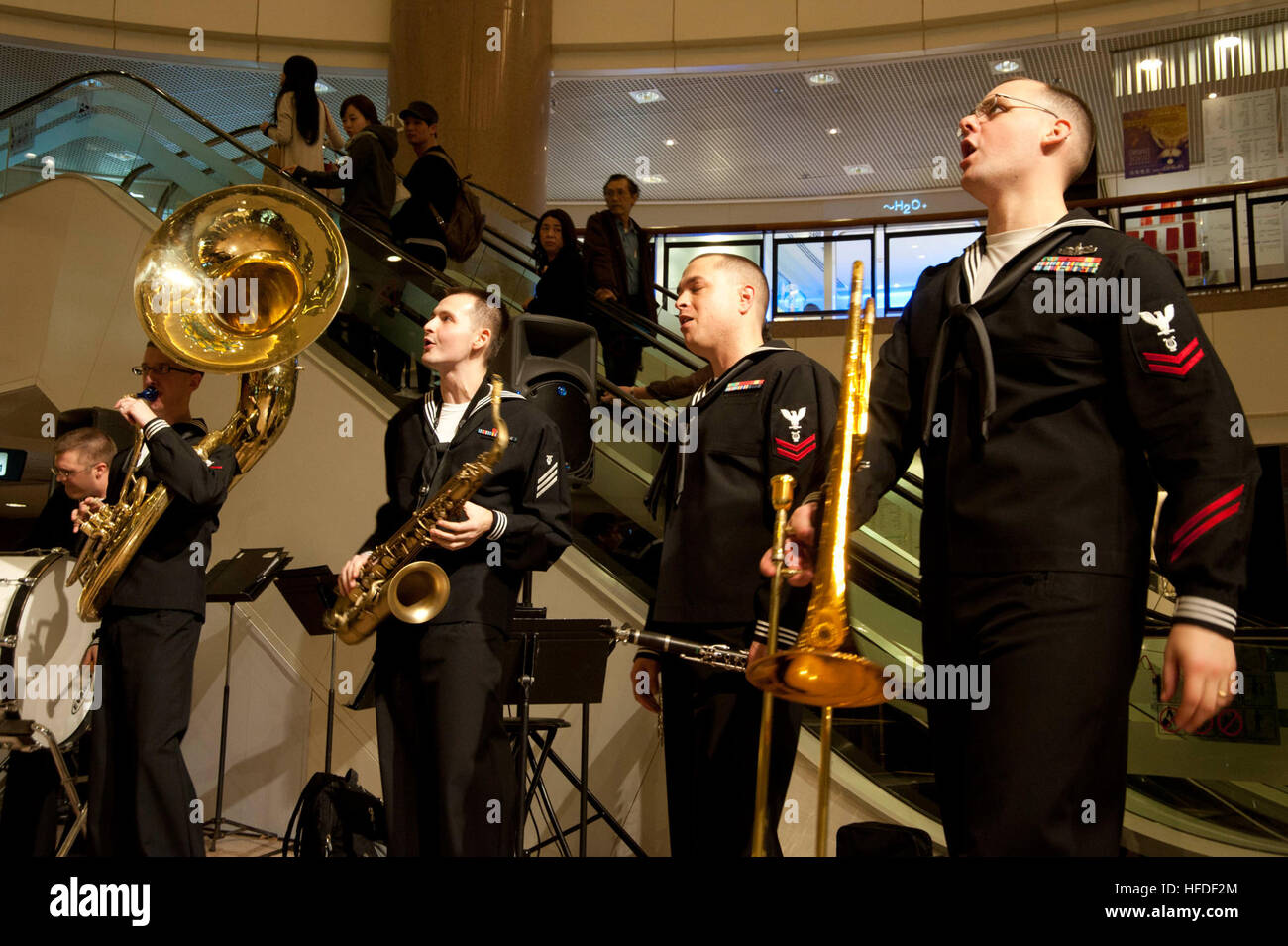 U.S. 7th Fleet Band members perform for locals at the Harbour City Mall in Hong Kong. Sailors from the U.S. 7th Stock Photo