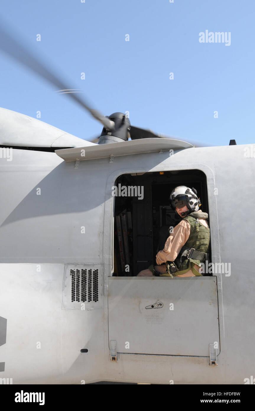 Marine Corps Staff Sgt. Jenna Kumdh, from Marine Medium Tiltrotor Squadron 162, looks out the window of an MV-22 Stock Photo