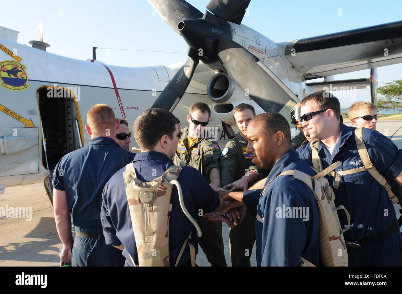 navy petty officer 3rd class kenneth powell an aviation machinist mate leads a group cheer with his flight crew at the us naval station guantanamo bay