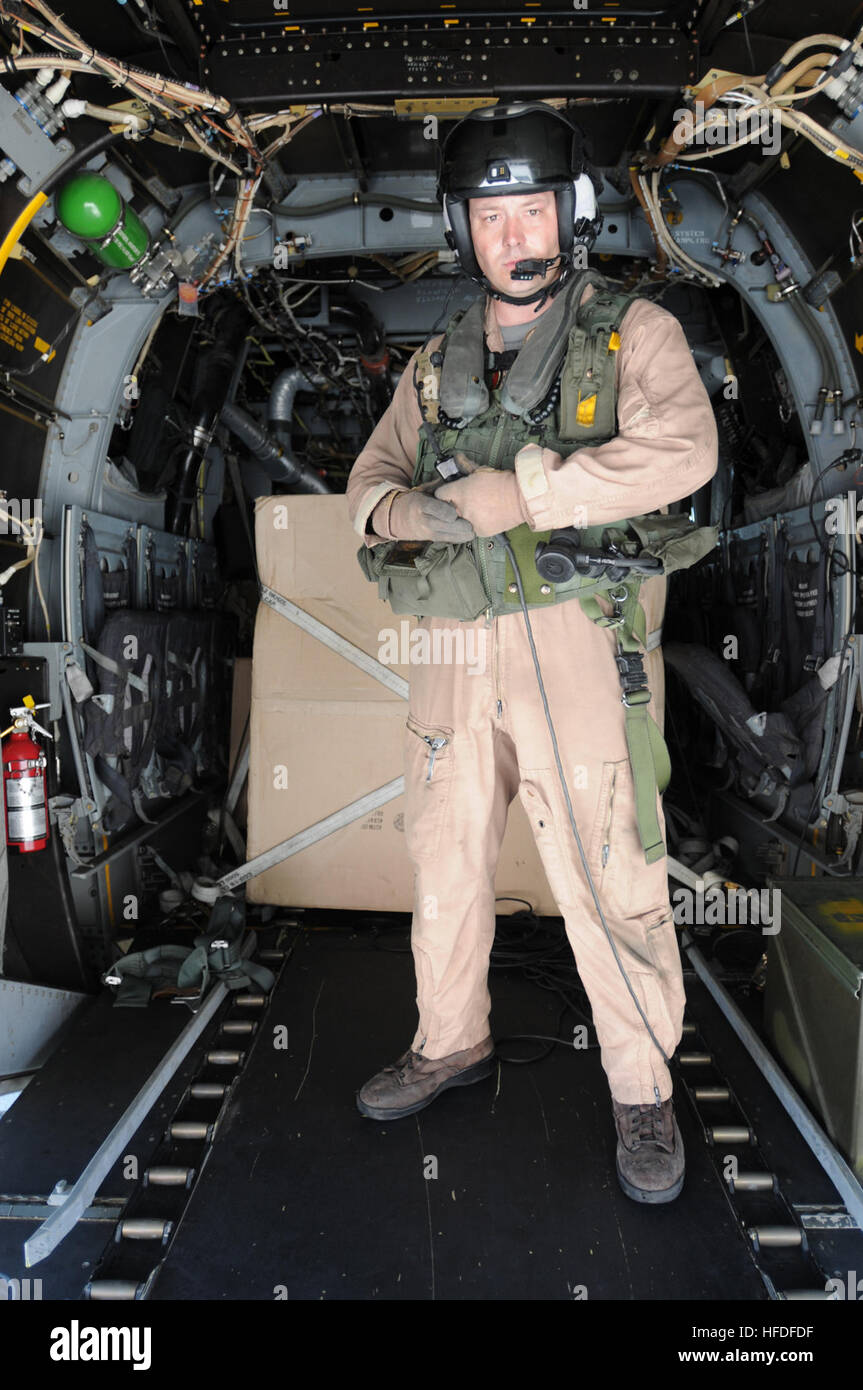 Marine Corps Sgt. Camaron Depue, from Marine Medium Tiltrotor Squadron 162, stands in the aft of an MV-22 Osprey Stock Photo