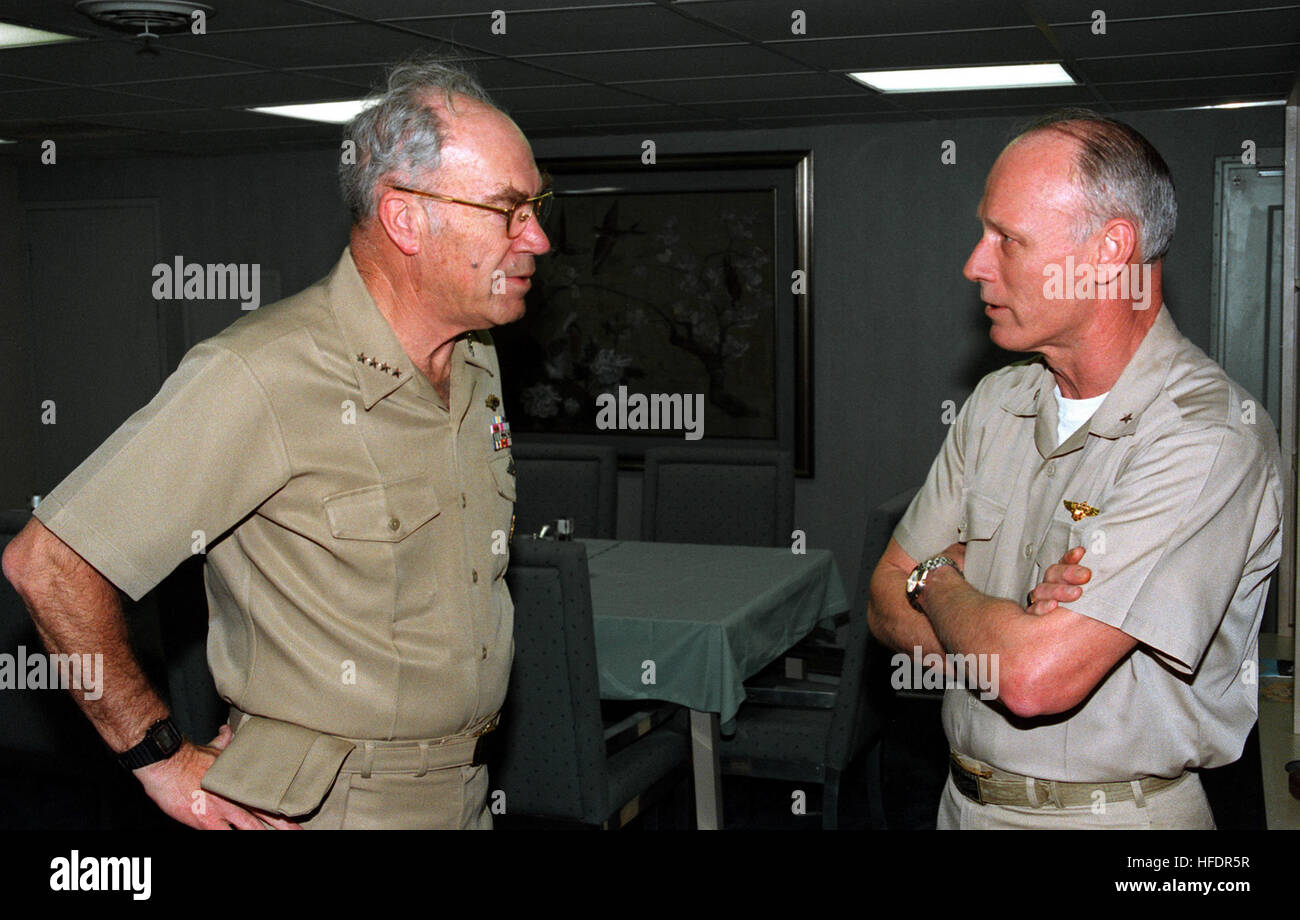 Rear Admiral Bernard J. Smith, Commander, Carrier Group Five (CVG-5) talks with Admiral Frank B. Kelso II, Chief - Stock Image
