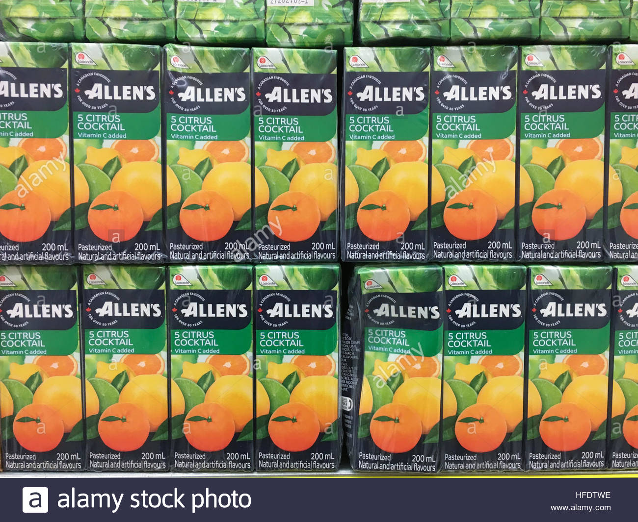 Allen's 5 Citrus Cocktail juice-boxes stacked on a supermarket shelf. Lassonde Industries Inc. is a Canadian - Stock Image