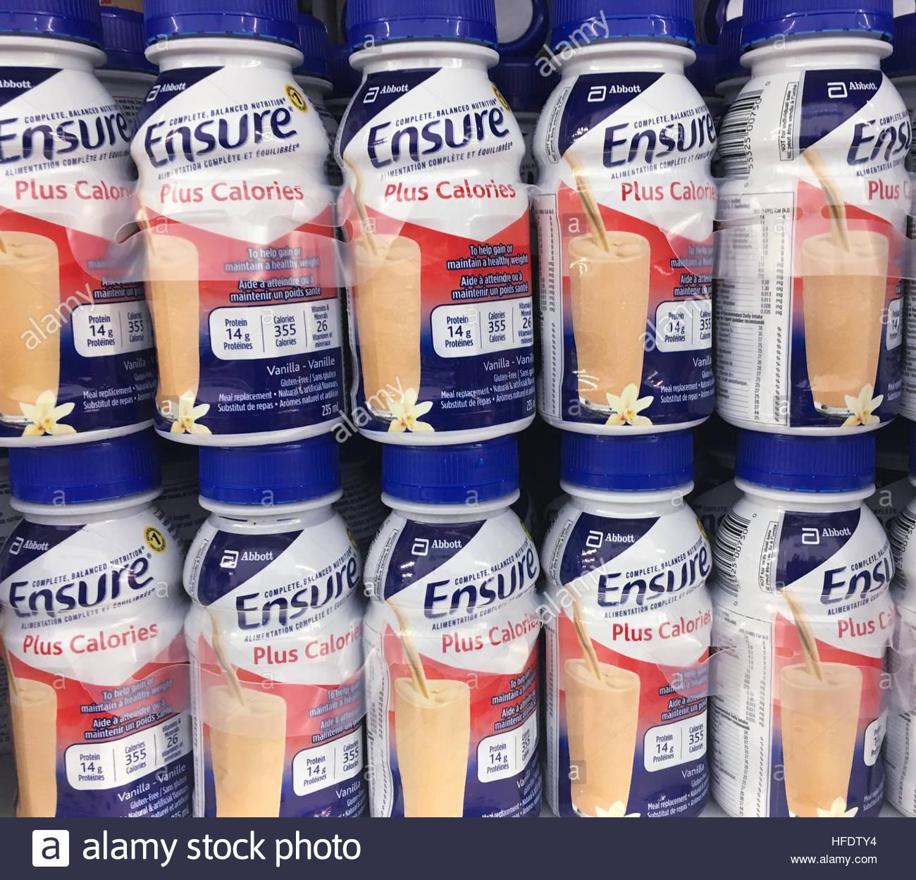 Ensure Plus Calories bottles stacked on a supermarket shelf  Ensure