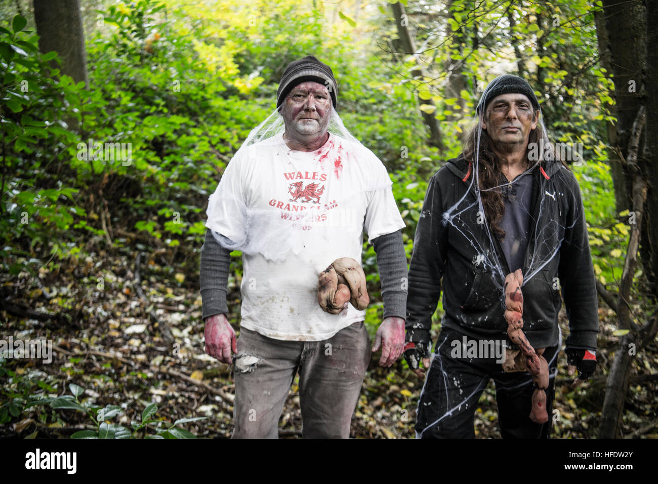 People dressed and made up as  zombies in the woods in a 'The Walking Dead Experience' Live Action Role - Stock Image