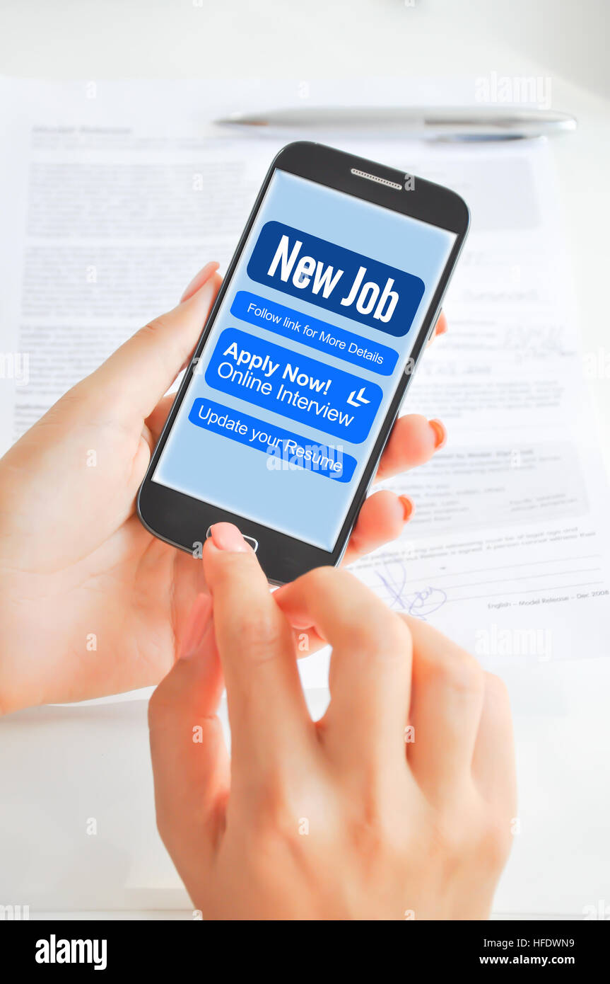 Apply for a job via smartphone or mobile device Stock Photo