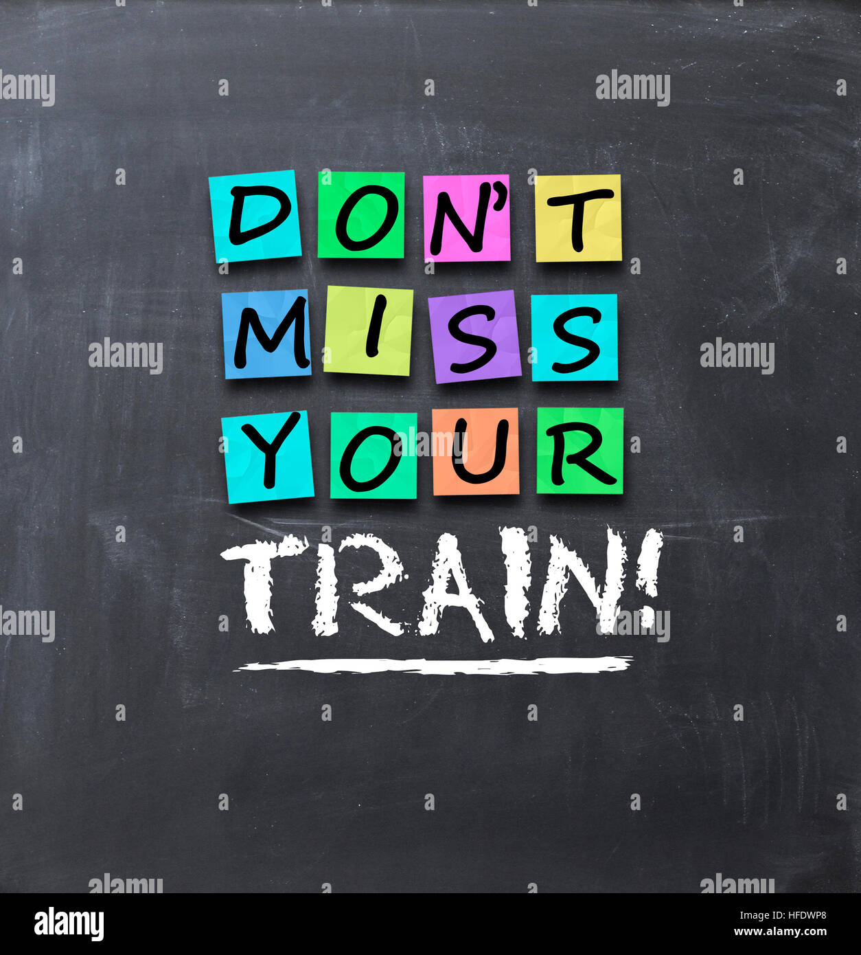 Don't miss your train text on colorful post-it notes stuck on blackboard Stock Photo