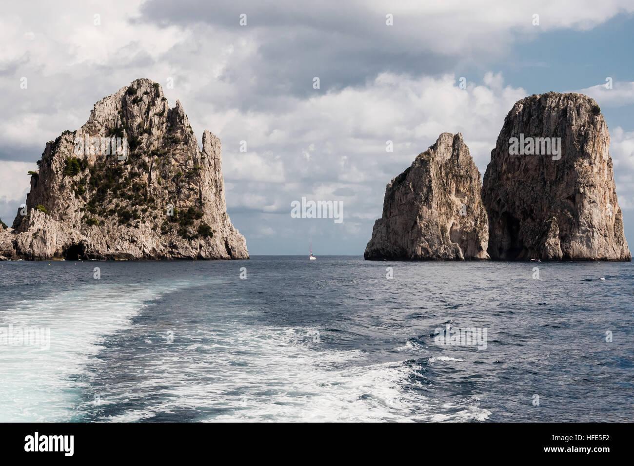 View from tourist boat on Faraglioni - three famous rocks,Capri, Italy - Stock Image