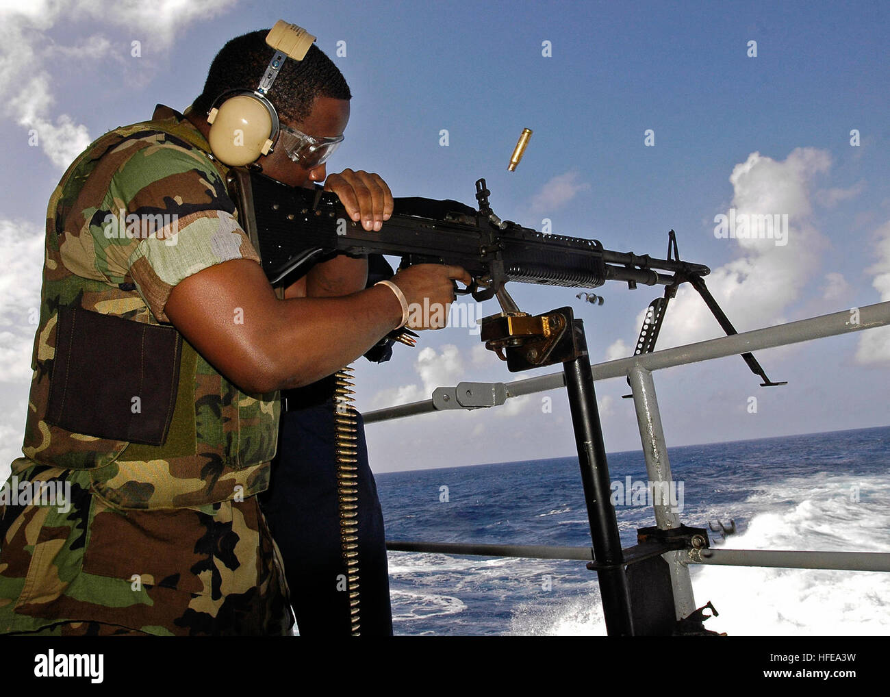 050220-N-4166B-020 Pacific Ocean (Feb. 20, 2005) - An empty shell casing ejects from the chamber of an M-60 machine - Stock Image