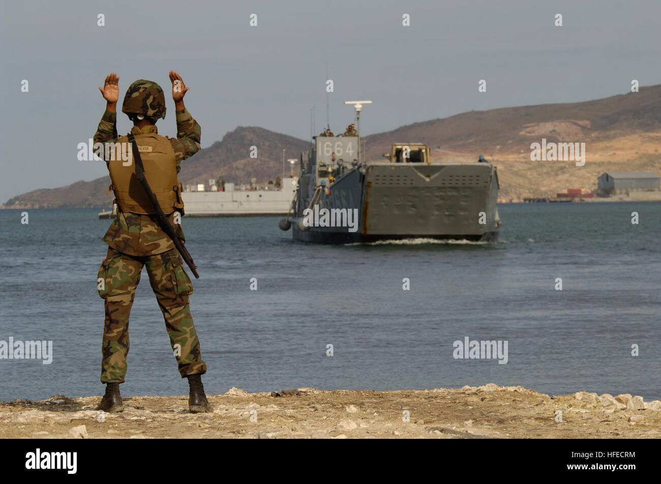 050509-N-3642E-008 Gonaives, Haiti (May 9, 2005) - Seaman Emanuel Walker from Beach Master Unit Two (BMU-2) directs - Stock Image