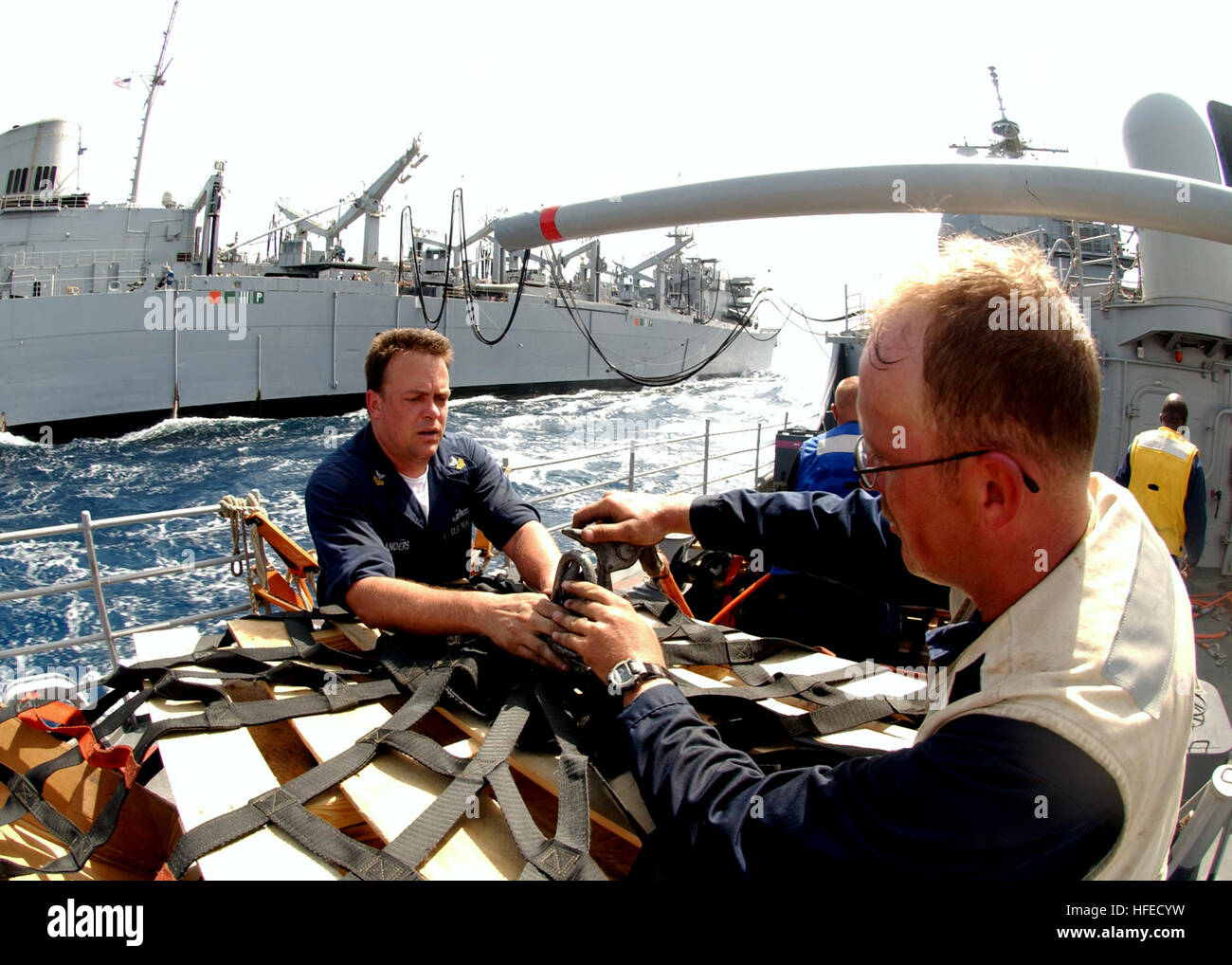 050514-N-5526M-005  Gulf of Aden (May 14, 2005) - Fire Controlman 1st Class Ron Sanders and Boatswain Mate 2nd Class - Stock Image
