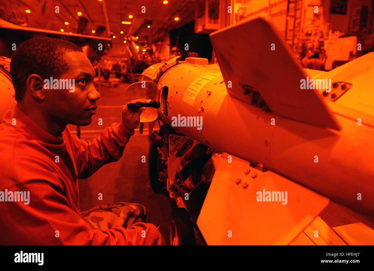 030327-N-7781D-032  The Mediterranean Sea (Mar. 27, 2003) Ð Aviation Ordnanceman complete checks of ordnance - Stock Image