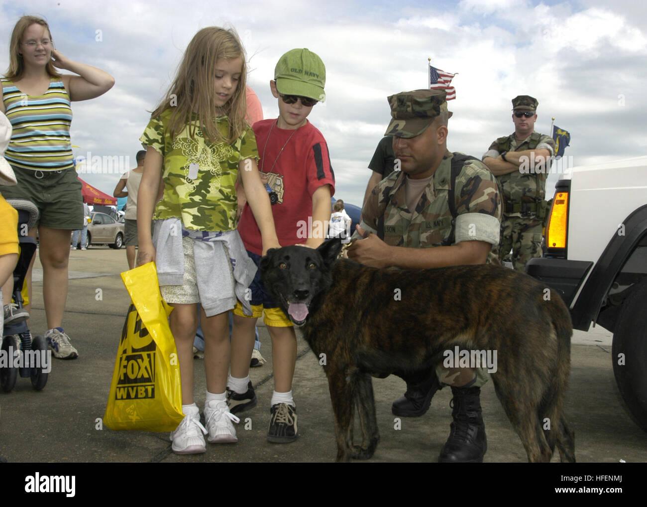 030907-N-5783F-086 Naval Air Station Oceana, Virginia Beach, Va. (Sep. 7, 2003) -- Children admire ÒTara,Ó a working Stock Photo