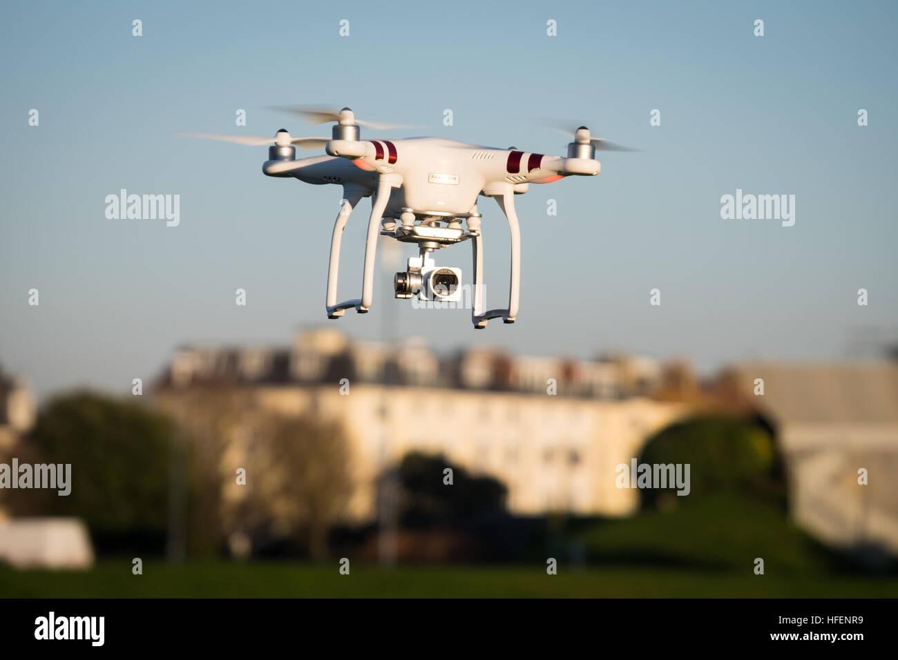 A DJI Phantom 3 Standard drone in flight near Southsea Castle - Stock Image