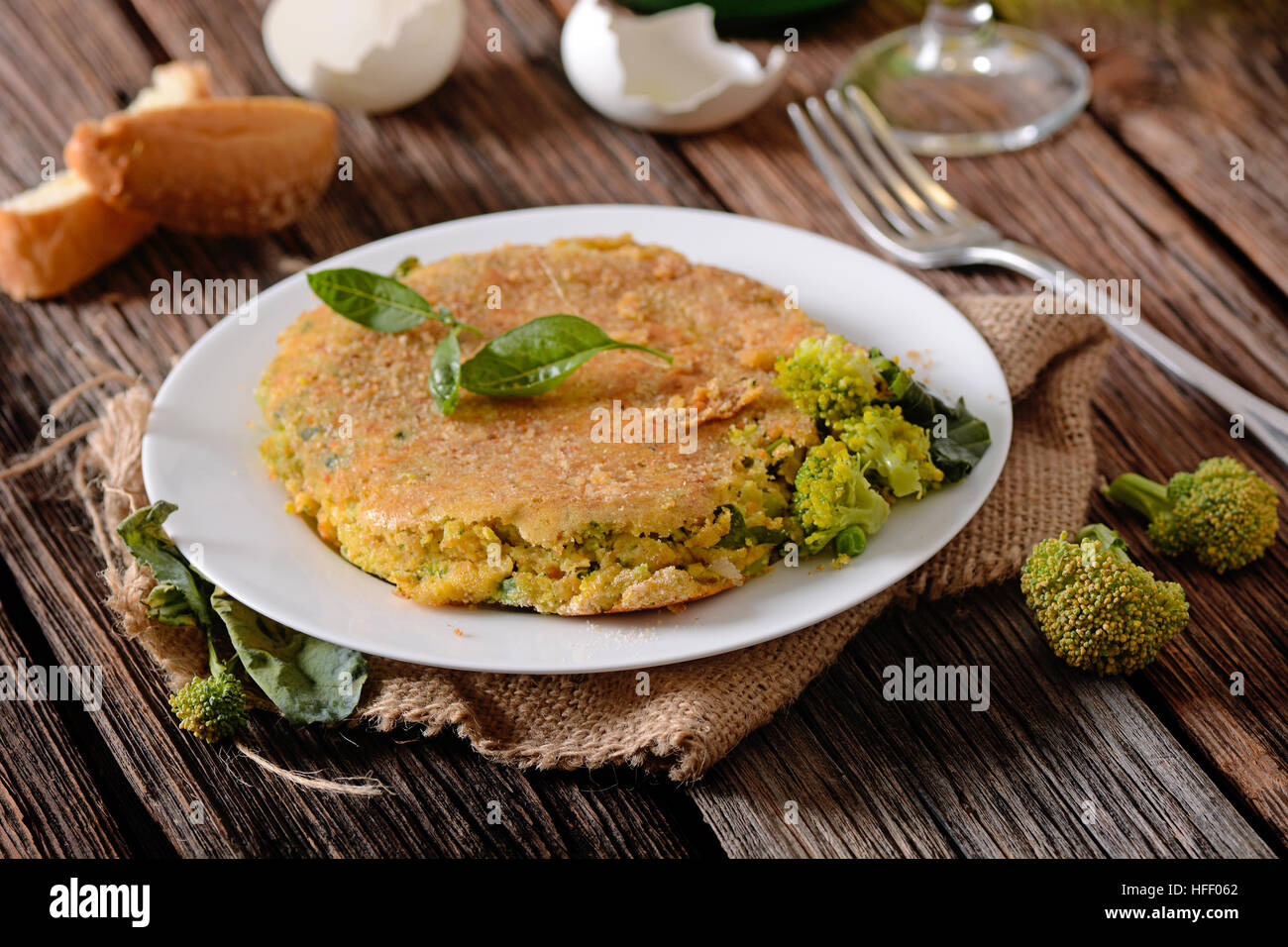 omelet with assorted vegetables - broccoli, green beans and zucchini - Stock Image